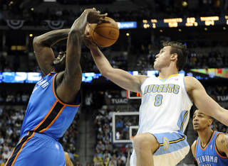 Denver Nuggets forward Danilo Gallinari (8) from Italy knocks the ball out of the hands of Oklahoma City Thunder center Kendrick Perkins (5) during the second half of game 3 of a first-round NBA basketball playoff series Saturday, April 23, 2011, in Denver. (AP Photo/Jack Dempsey)