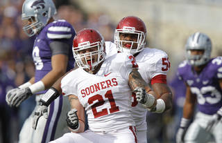 Oklahoma Sooners' Tom Wort (21) and Ronnell Lewis (56) celebrate after a sack during the college football game between the University of Oklahoma Sooners (OU) and the Kansas State University Wildcats (KSU) at Bill Snyder Family Stadium on Saturday, Oct. 29, 2011. in Manhattan, Kan. Photo by Chris Landsberger, The Oklahoman ORG XMIT: KOD