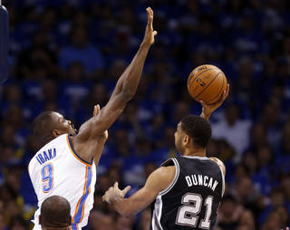 Oklahoma City's Serge Ibaka (9) blocks San Antonio's Tim Duncan (21) during Game 4 of the Western Conference Finals in the NBA playoffs between the Oklahoma City Thunder and the San Antonio Spurs at Chesapeake Energy Arena in Oklahoma City, Tuesday, May 27, 2014. Photo by Nate Billings, The Oklahoman