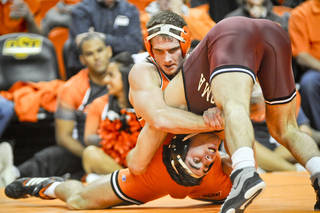 At 165 pounds, Oklahoma's Bubby Graham won by a decision over Oklahoma State's Dallas Bailey by a final tally of 6-2. KT King/For the Tulsa World