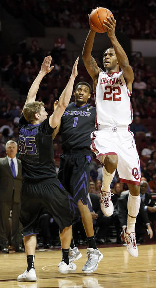 Oklahoma's Amath M'Baye (22) shoots against Kansas State's Will Spradling (55) and Shane Southwell (1) during an NCAA men's basketball game between the University of Oklahoma (OU) and Kansas State at the Lloyd Noble Center in Norman, Okla., Saturday, Feb. 2, 2013. Photo by Nate Billings, The Oklahoman