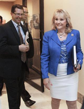 Oklahoma Gov. Mary Fallin, right, and Speaker of the Oklahoma House Kris Steele, left, leave a closed door meeting in Oklahoma City, Thursday, May 17, 2012. Leaders in the Republican-controlled Legislature and Fallin still have not reached a deal on how a state income tax cut would work. (AP Photo/Sue Ogrocki) ORG XMIT: OKSO105