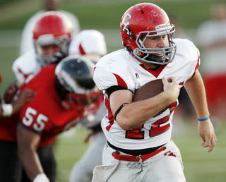Carl Albert's Taylor Hawkins carries the ball during a high school football scrimmage at Del City High School in Del City, Okla., Friday, Aug. 19, 2011. Photo by Nate Billings, The Oklahoman ORG XMIT: KOD