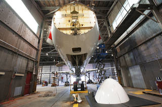 An aircraft undergoes maintenance at First Wave, in one of the hangars at the Oklahoma Spaceport in Burns Flat. Photo by David McDaniel, THE OKLAHOMAN