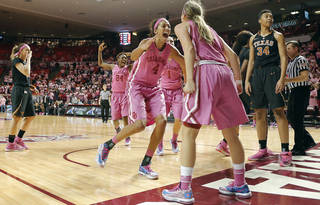 Oklahoma's Sharane Campbell (24) Nicole Griffin (4) and Morgan Hook (10) react after Hook was fouled with four seconds left in the game during the women's college basketball game between the University of Oklahoma Sooners (OU) and the University of Texas Longhorns (UT) at the Lloyd Noble Center in Norman, Okla. on Wednesday, Feb. 19, 2014. Oklahoma won the game 64-63 Photo by Chris Landsberger, The Oklahoman