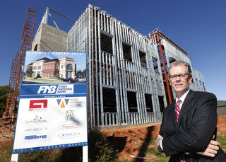 Mel Martin, president of First National Bank of Oklahoma, poses at the construction site of a new branch opening in May 2014 at 5101 N Western. Photo by Steve Gooch, The Oklahoman Steve Gooch