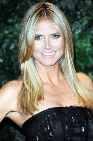 Heidi Klum arrives at the QVC Red Carpet Style at the Four Seasons Hotel on Friday, Feb. 22, 2013 in Los Angeles. (Photo by Richard Shotwell/Invision/AP) ORG XMIT: CARS103