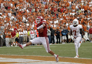 OU's Trey Millard (33) high steps in the end zone for a touchdown past UT's Demarco Cobbs (7) during the Red River Rivalry college football game between the University of Oklahoma (OU) and the University of Texas (UT) at the Cotton Bowl in Dallas, Saturday, Oct. 13, 2012. Photo by Chris Landsberger, The Oklahoman
