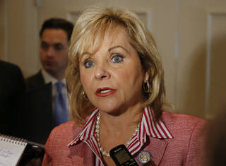 Oklahoma Gov. Mary Fallin talks with reporters in Oklahoma City, Wednesday, July 17, 2013, following a speech to the National Lieutenant Governors Association annual meeting. (AP Photo/Sue Ogrocki)