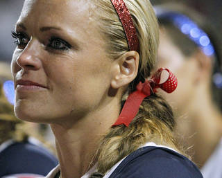 Jennie Finch reacts as she watches a video presentation from her teammates during a ceremony following the United States' win over Japan in the World Cup of softball championship. PHOTO BY JOHN CLANTON, THE OKLAHOMAN