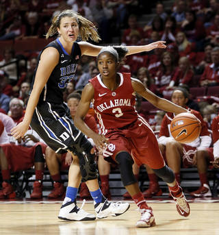 OU's Aaryn Ellenberg (3) dribbles away from Duke's Haley Peters (33) in the second half during a women's college basketball game between the Oklahoma Sooners and the Duke Blue Devils at Lloyd Noble Center in Norman, Okla., Sunday, Dec. 8, 2013. Duke won, 94-85. Photo by Nate Billings, The Oklahoman