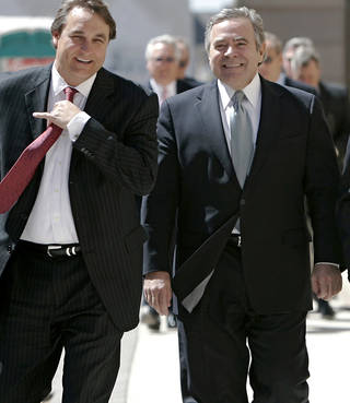 Mike Morgan, right, and Attorney David Ogle, left, walk toward the Federal Courthouse in Oklahoma City on Wednesday, April 6, 2011. Former Senate leader Mike Morgan, lobbyist Andrew Skeith and attorney Martin Stringer pleaded not guilty to federal bribery, conspiracy, extortion and mail fraud charges. (AP Photo/The Oklahoman, John Clanton) ORG XMIT: OKOKL101