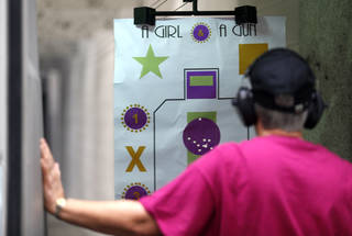 Kerry McNutt looks at her target board during a women's shooting gun club at H&H Shooting Sports Complex in Oklahoma City, Okla., Tuesday, Aug. 12, 2014. Photo by Sarah Phipps, The Oklahoman