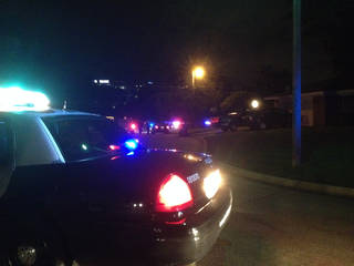Police investigate the scene Monday night after an officer-involved shooting at NW61 and Quapaw Avenue. Photo by LeighAnne Manwarren, The Oklahoman -