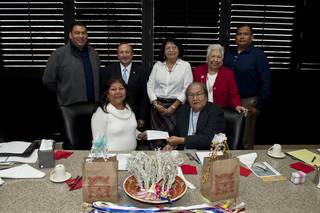 Cheyenne and Arapaho Gov. Janice Boswell, bottom left, recently presented a $500,000 check to the Cheyenne and Arapaho Tribal College located on the campus of Southwestern Oklahoma State University in Weatherford. Chief Lawrence Hart, bottom right, chairman of the board of regents for the tribes, accepted for the college. Others present were, back row from left: Cornell Sankey, SWOSU President Randy Beutler, Ida Hoffman, tribal President Henrietta Mann and Parry Roman Nose. PHOTO PROVIDED
