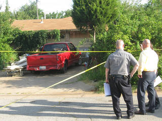 Oklahoma City police investigate the scene where a father reportedly fatally shot his son after being attacked with a hatchet Sunday at 408 NW 89, said Lt. Jeff Cooper. Photo by Matt Dinger, The Oklahoman