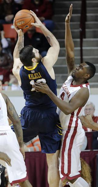 Oklahoma's Andrew Fitzgerald (4) defends on West Virginia 's Deniz Kilicli (13) during the first half of the college basketball game between the University of Oklahoma Sooners (OU) and the West Virginia University Mountaineers (WVU) at the Lloyd Noble Center on Wednesday, March 6, 2013, in Norman, Okla. Photo by Chris Landsberger, The Oklahoman