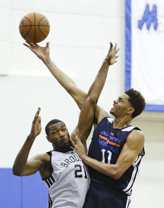 Oklahoma City Thunder's Jeremy Lamb (11) collides with Brooklyn Nets' Cory Jefferson (21) while going up for a shot during an NBA summer league basketball game in Orlando, Fla., Monday, July 7, 2014. (AP Photo/John Raoux)