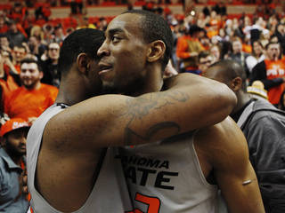 Oklahoma State senior guard Markel Brown (right) hugs teammate Marcus Smart (left) after an NCAA college basketball game between Oklahoma State University (OSU) and Kansas State held in Gallagher-Iba Arena in Stillwater, Okla., Monday, March 3, 2014. Oklahoma State defeated Kansas State 77-61. Photo by KT King/ For The Oklahoman