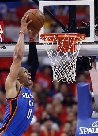 Oklahoma City's Russell Westbrook (0) dunks during Game 3 of the Western Conference semifinals in the NBA playoffs between the Oklahoma City Thunder and the Los Angeles Clippers at the Staples Center in Los Angeles, Friday, May 9, 2014. Photo by Nate Billings, The Oklahoman