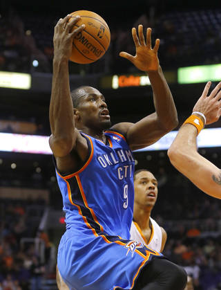 Oklahoma Thunder forward Serge Ibaka, of Congo, shoots against the Phoenix Suns during the first half of an NBA preseason basketball game, Tuesday, Oct. 22, 2013, in Phoenix. (AP Photo/Matt York)