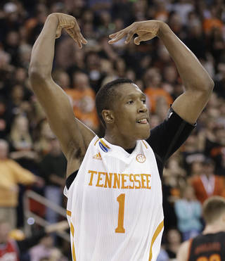 Tennessee guard Josh Richardson (1) reacts to a goal against Mercer during the first half of an NCAA college basketball third-round tournament game, Sunday, March 23, 2014, in Raleigh. (AP Photo/Gerry Broome)