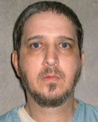 This photo provided by the Oklahoma Department of Corrections shows Richard Glossip. An Oklahoma court has scheduled a Nov. 20, 2014 execution date for the convicted killer while the stateÂ's protocol is under review following a botched execution. The Oklahoma Court of Criminal Appeals on Glossip has exhausted his appeals. (AP Photo/Oklahoma Department of Corrections)