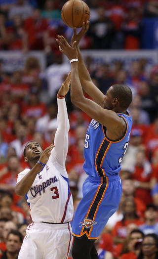Oklahoma City's Kevin Durant (35) shoots over Chris Paul (3) late in Game 3 of the Western Conference semifinals in the NBA playoffs between the Oklahoma City Thunder and the Los Angeles Clippers at the Staples Center in Los Angeles, Friday, May 9, 2014. Photo by Nate Billings, The Oklahoman