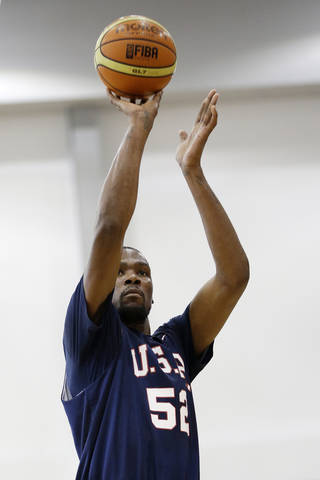 Oklahoma City Thunder's Kevin Durant (52) shoots a free throw during a USA Basketball minicamp scrimmage Monday, July 28, 2014, in Las Vegas. (AP Photo/John Locher)