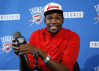 Oklahoma City Thunder forward Kevin Durant smiles during an NBA basketball news conference in Oklahoma City, Thursday, May 16, 2013. Torpedoed by an injury to All-Star point guard Russell Westbrook, the Thunder's season is over far sooner than expected. After making it to the NBA Finals last season, Oklahoma City couldn't make it out of the second round this year with Westbrook sidelined.(AP Photo/Sue Ogrocki) ORG XMIT: OKSO105