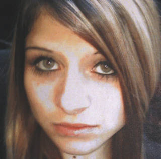 "FILE - This undated file photo provided by the Bethany Police Department, in Bethany, Okla. shows Carina Saunders. According to an autopsy report released by the Office of the Chief Medical Examiner, Saunders, whose dismembered body was discovered in a duffel bag in a western Oklahoma City suburb last year, was murdered, and lists the cause as ""violent death,"" but it does not indicate whether she was alive when her body was dismembered. (AP Photo/Bethany Police Department, File) ORG XMIT: OKSO101"