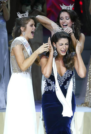 Miss Oklahoma 2014 Alexandra Eppler, foreground, from Enid, is crowned by Miss Oklahoma Outstanding Teen Joei Whisenant, left, and Miss Oklahoma 2013 Kelsey Griswold. PhotoS by James Gibbard, Tulsa World JAMES GIBBARD