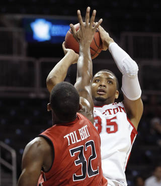 Texas Tech forward Jordan Tolbert (32) defends as Houston forward TaShawn Thomas (35) takes a shot in the second half of their NCAA college basketball game, the consolation game of the Legends Classic, Tuesday, Nov. 26, 2013, in New York. (AP Photo/Kathy Willens)