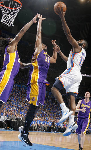 Oklahoma City's James Harden (13) goes to the basket beside Los Angeles' Andrew Bynum (17) and Los Angeles' Jordan Hill (27) during Game 1 in the second round of the NBA playoffs between the Oklahoma City Thunder and the L.A. Lakers at Chesapeake Energy Arena in Oklahoma City, Monday, May 14, 2012. Photo by Sarah Phipps, The Oklahoman