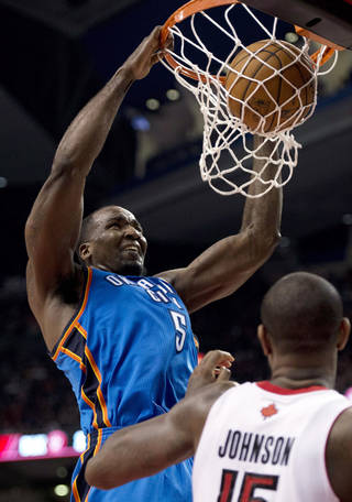 Oklahoma City Thunder center Kendrick Perkins (5) dunks in front of Toronto Raptors forward Amir Johnson (15) during the second half of an NBA basketball game in Toronto on Sunday, Jan. 6, 2013. (AP Photo/The Canadian Press, Frank Gunn) ORG XMIT: FNG113