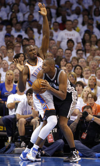 Oklahoma City's Serge Ibaka (9) defends against San Antonio's Boris Diaw (33) during Game 6 of the Western Conference Finals in the NBA playoffs between the Oklahoma City Thunder and the San Antonio Spurs at Chesapeake Energy Arena in Oklahoma City, Saturday, May 31, 2014. Photo by Bryan Terry, The Oklahoman