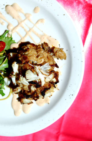 Crab cakes at Rococo are served with Thai-infused dressing, and wild field greens. John Clanton - The Oklahoman