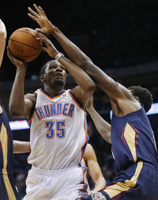 Oklahoma City Thunder forward Kevin Durant (35) is fouled by New Orleans Pelicans Al-Farouq Aminu, right, during the third quarter of an NBA basketball preseason game in Tulsa, Okla., Thursday, Oct. 17, 2013. New Orleans won 105-102. (AP Photo/Sue Ogrocki) ORG XMIT: OKSO119