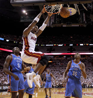 Miami's Chris Bosh (1) dunks the ball as Oklahoma City's Kendrick Perkins (5) and Oklahoma City's Kevin Durant watch during Game 3 of the NBA Finals between the Oklahoma City Thunder and the Miami Heat at American Airlines Arena, Sunday, June 17, 2012. Photo by Bryan Terry, The Oklahoman