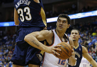 OKC's Steven Adams looks for a shot in the post past Ryan Anderson and the New Orleans Pelicans, at the BOK Center, on Thursday, Oct. 17, 2013. CORY YOUNG/Tulsa World ORG XMIT: DTI1310172151172817