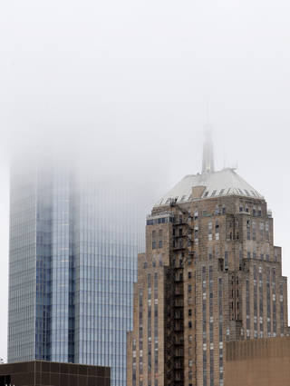 Devon Energy and First National Center buildings disappear Thursday into low-hanging clouds that brought rain to Oklahoma City.Photo by Paul B. Southerland, The Oklahoman PAUL B. SOUTHERLAND - PAUL B. SOUTHERLAND
