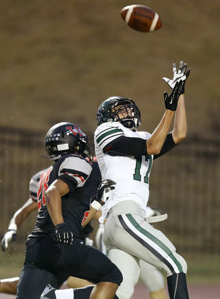 Norman North's Channing Meyer catches a touchdown pass in front of Westmoore's Lexus Lee during a high school football game in Moore, Okla., Thursday, September 13, 2012. Photo by Bryan Terry, The Oklahoman