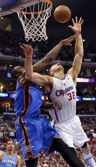 Oklahoma City's Serge Ibaka (9) fouls Los Angeles' Blake Griffin (32) in the fourth quarter during Game 4 of the Western Conference semifinals in the NBA playoffs between the Oklahoma City Thunder and the Los Angeles Clippers at the Staples Center in Los Angeles, Sunday, May 11, 2014. Photo by Nate Billings, The Oklahoman