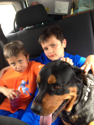 Gage (left) and Kaden Knox are pictured with their dog Max, who survived the tornadoes. They lost one rottweiler in the storm. PHOTO PROVIDED