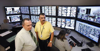 Sheriff John Whetsel, left, and jail administrator Maj. Jack Herron are in the camera monitoring room at the Oklahoma County jail. The monitoring system is among about $10 million in improvements made at the jail since the U.S. Department of Justice identified a number of civil rights violations there. PHOTO BY DAVID MCDANIEL, THE OKLAHOMAN