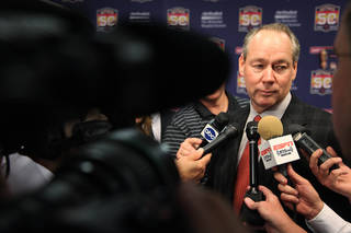 Houston Astros owner Jim Crane talks to reporters at Minute Maid Park on Monday, Jan. 23, 2012, in Houston. Crane was considering changing the name of the franchise as well as its uniforms. Crane said Monday the team would not change names. (AP Photo/Houston Chronicle, Mayra Beltran) MANDATORY CREDIT ORG XMIT: 431676