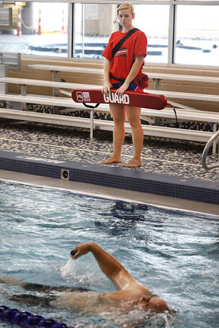 Lifeguard Skye DeShay works at the Mitch Park YMCA in Edmond, which requires more lifeguards than many YMCA pools. Photo by David McDaniel, The Oklahoman David McDaniel -