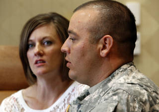 Margie and Staff Sgt. Chris Solis talk about their participation in the Yellow Ribbon Program for the families of deploying troops June 1 in Norman. Photo by Steve Sisney, The Oklahoman STEVE SISNEY