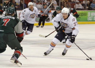 AHL HOCKEY / PLAYOFFS: OKC's Anton Lander (37) skates against Houston's Kris Fredheim (7) during a game between the Oklahoma City Barons and the Houston Aeros at the Cox Convention Center in Oklahoma City, Sunday, April 22, 2012. Photo by Garett Fisbeck, For The Oklahoman