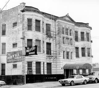 The Hotel Marion, a survivor of Urban Renewal clearance efforts when the photo was taken in 1979. But the property continued to decline, with the Marion closing soon afterward. - BY PAUL SOUTHERLAND THE OKLAHOMAN ARCHIVE